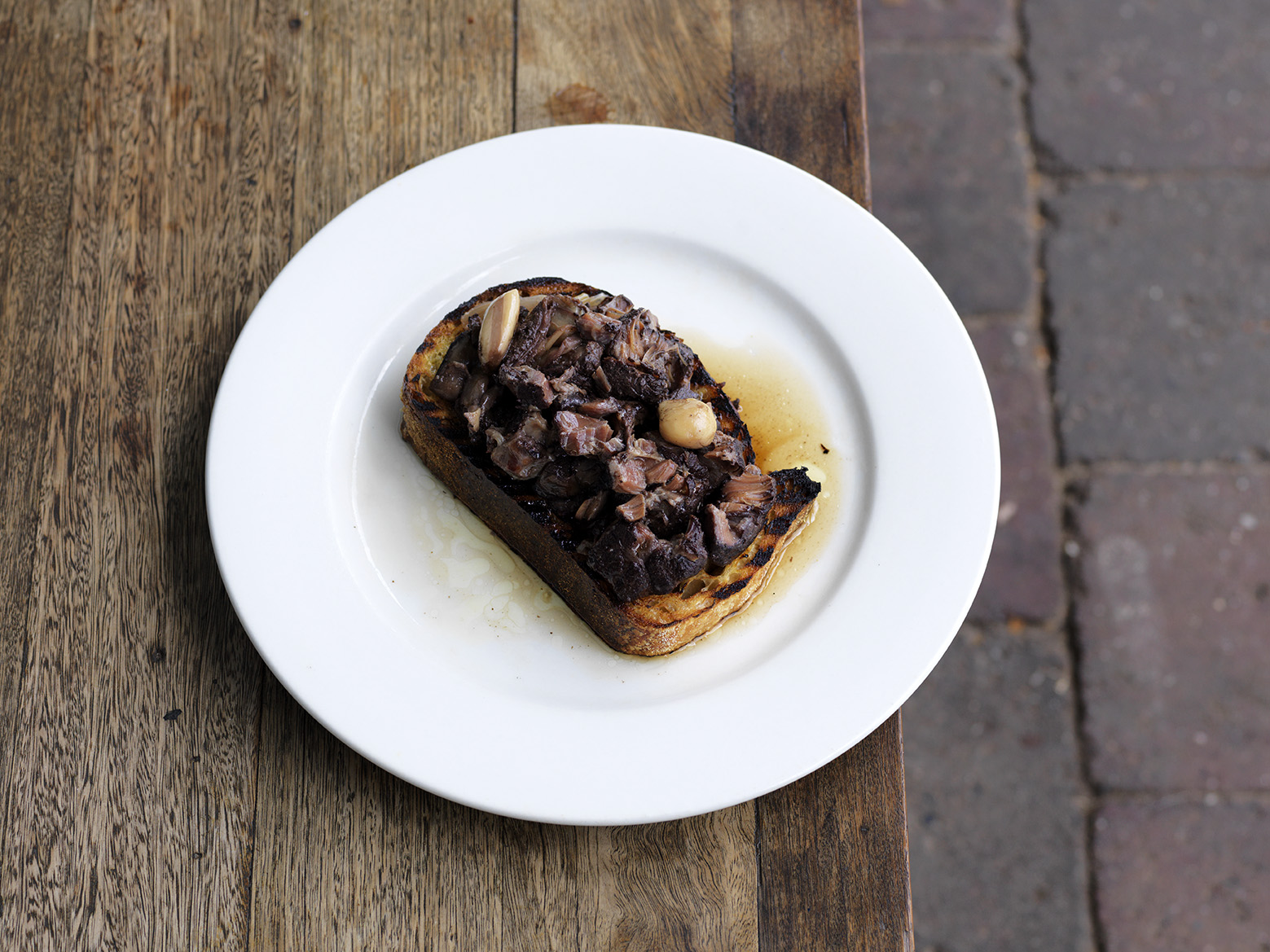 Menu development involves thinking about other parts that can and should be used and letting quality produce do the talking - like this beef shin braised in red wine and garlic and served on grilled sourdough at Ethel.