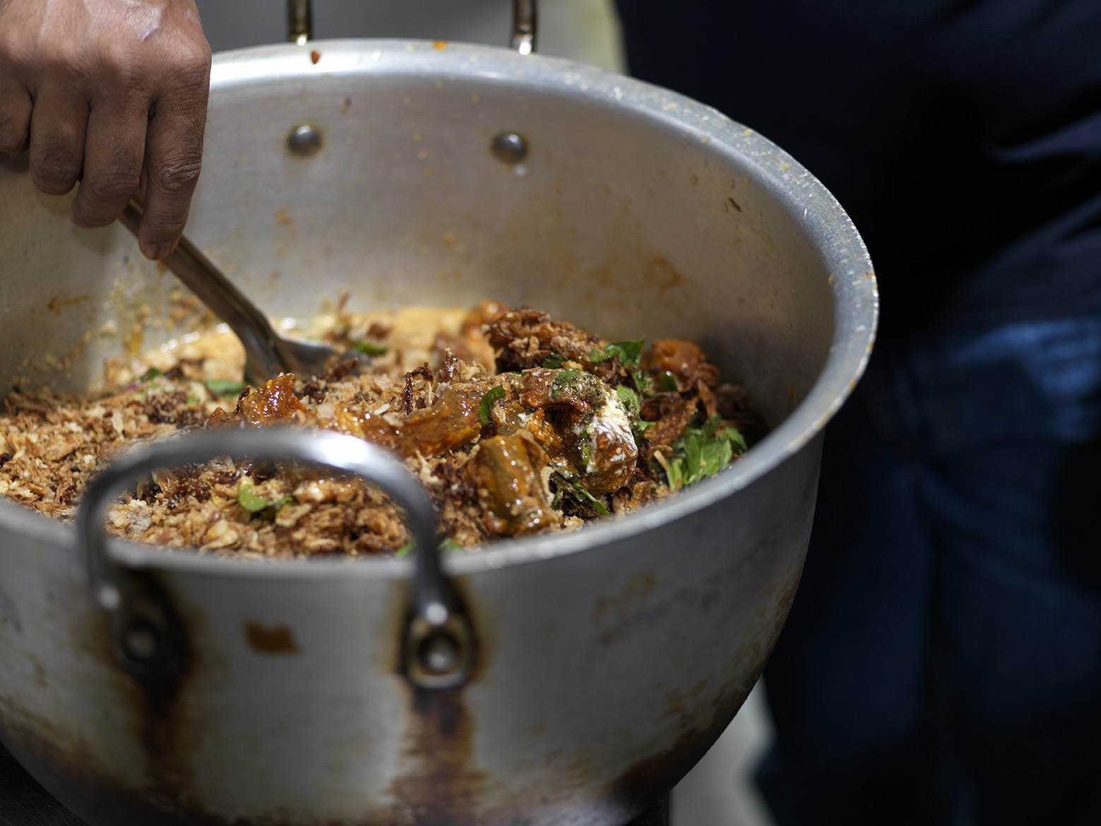 25+ ingredients including diced goat meat are cooked together using the traditional biryani method.
