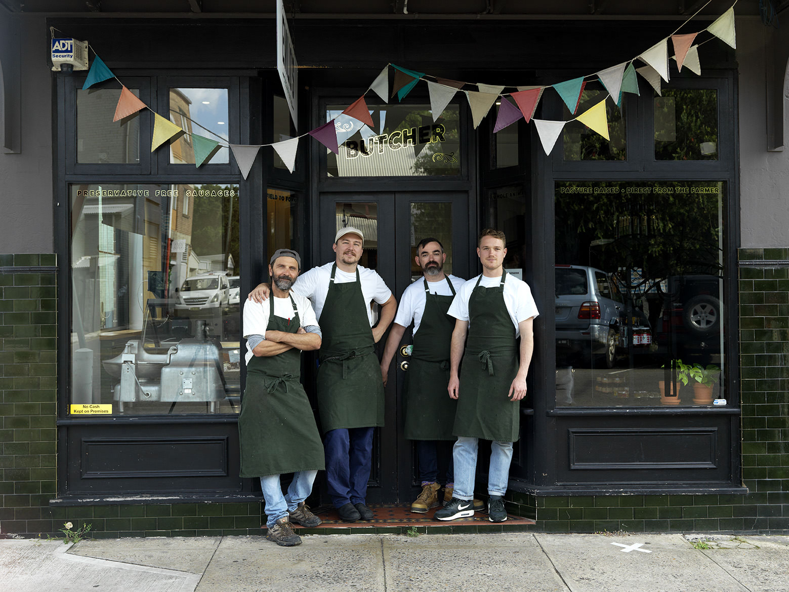 Milko (left) and Will (right) with some of the Emilio's team outside their Rozelle butcher shop.