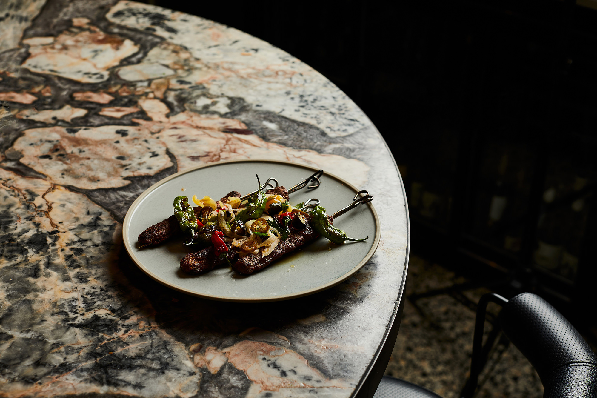 Rose harissa-spiced lamb kebab, raw onion and pickled chillies.