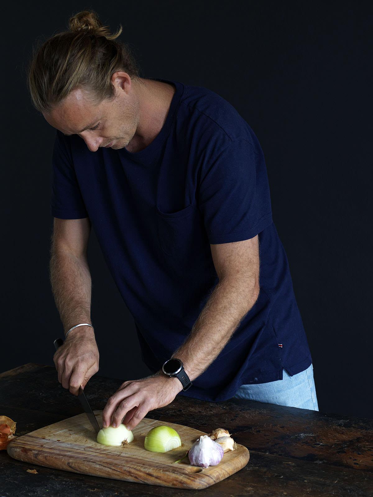 Guy preparing ingredients for his one-pot wonder.