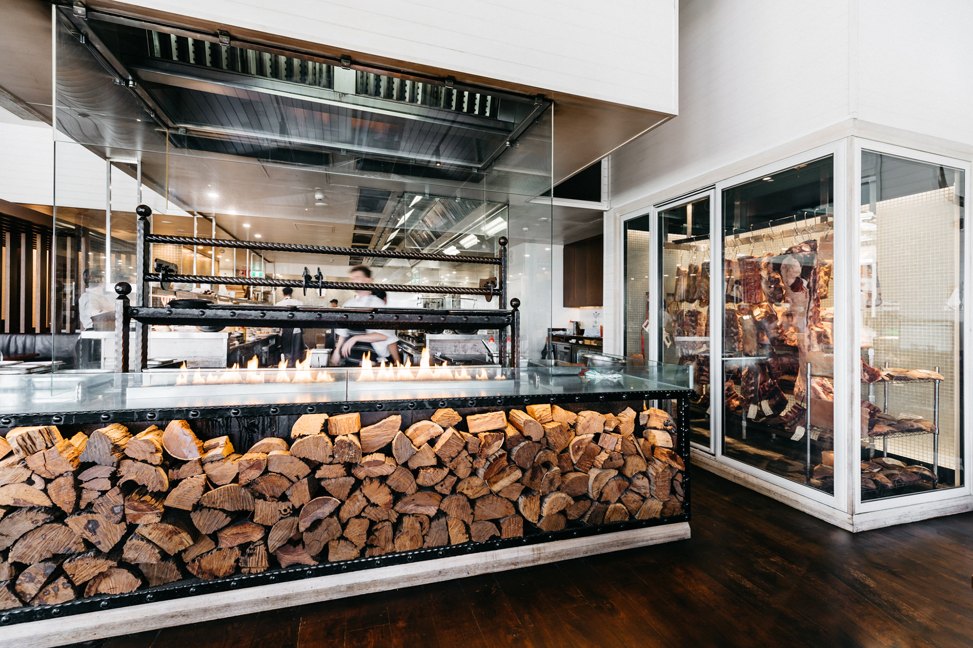The Regatta Hotel's open kitchen, two metre flame-grill and dry age cabinet.