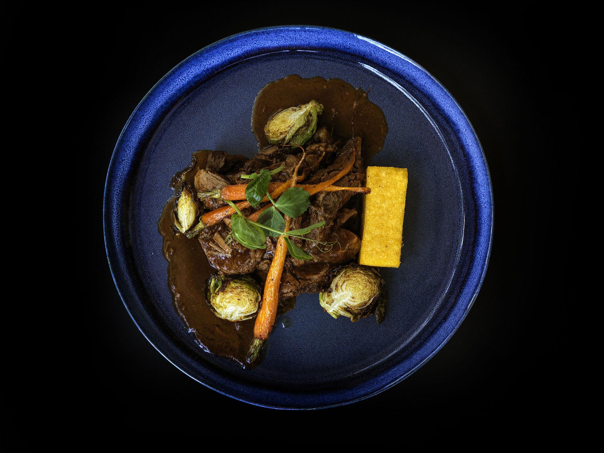 Braised Moroccan-spiced lamb shoulder, crispy polenta, fried brussels and honey glazed carrots.