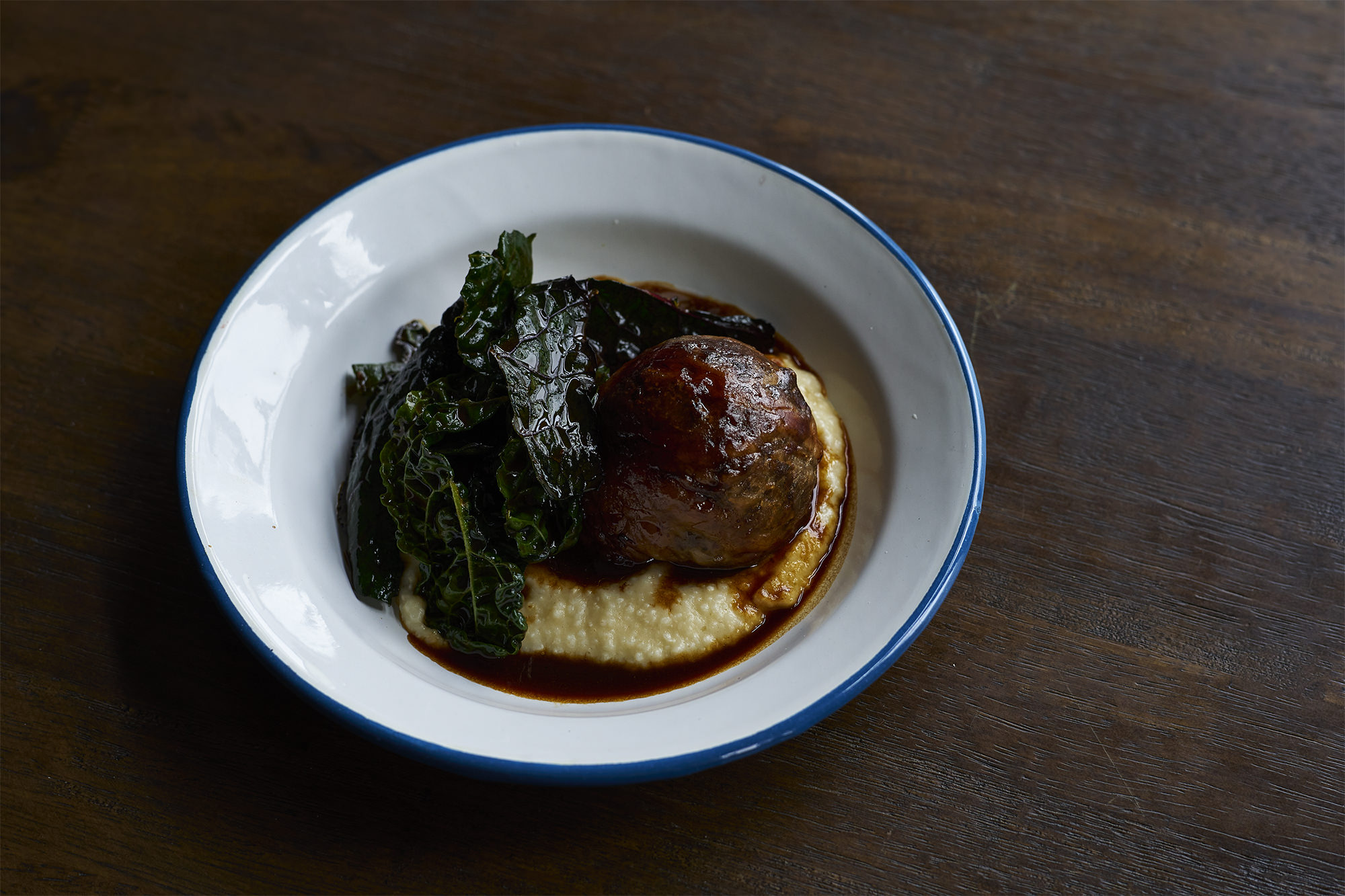 Pub grub - crepinette of goat shoulder, liver and heart with rice polenta and spigarello.